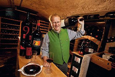 Reinhold Baumschlager at his own wine-cellar