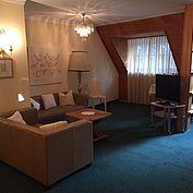Komfortzimmer mit Wohnbereich im Landhotel Forsthof