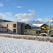Landhotel Stockerwirt - Hotelansicht im Winter mit neuem Panoramaflügel